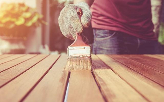 Application of primer on wood