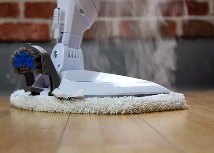 vacuuming the laminate flooring with a soft brush