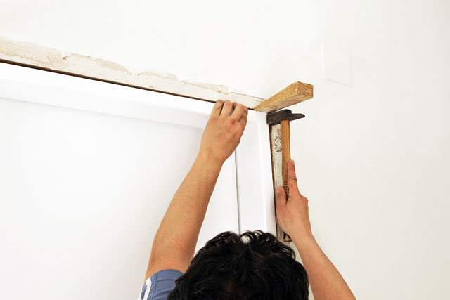 fix a warped door with wooden plates and wedges