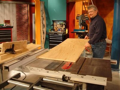 Lay the plywood against the table saw fence