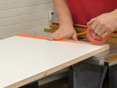 Use painters tape to protect the melamine